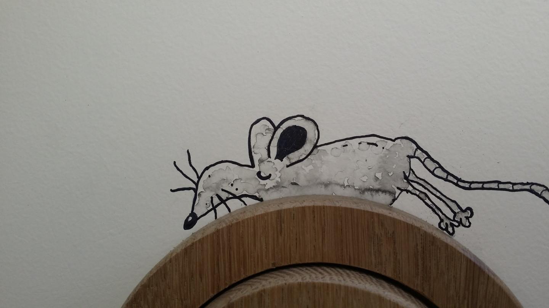 Piešta pelė. Laikrodis. Detalė