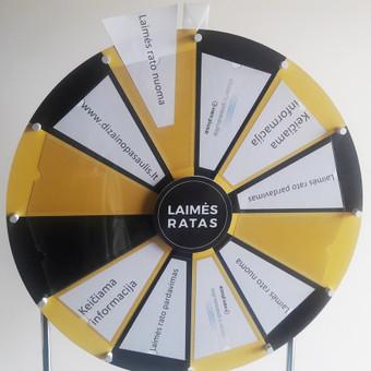 Komplektą sudaro: instrukcija, konstrukcijos, ratas, surinkimo detalės. ▪️Gamybos terminas 1 – 2 savaitės. ▪️Laimės ratas mobilus, lengvai transportuojamas.